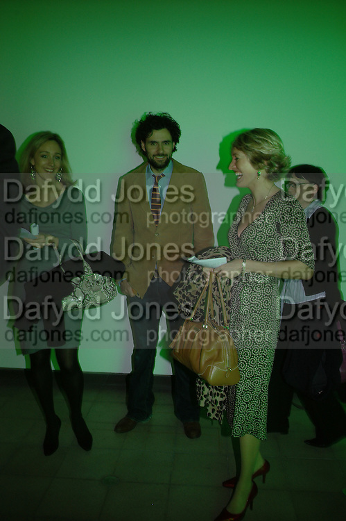 Kate Pakenham, Tom Guard and Isabella Sherlock. Dan Flavin ' A Retrospective'  exhibition opening. Hayward Gallery.  18 January 2006.  ONE TIME USE ONLY - DO NOT ARCHIVE  © Copyright Photograph by Dafydd Jones 66 Stockwell Park Rd. London SW9 0DA Tel 020 7733 0108 www.dafjones.com