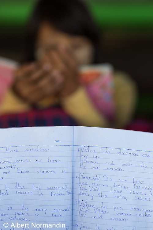 English lesson book with out of focus student, Ayetharyar Township