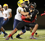 The Lions' Jake Smith tackles Miklo Smalls during a game against Plano East Senior High on Friday, Oct. 14, 2016 at Tom Kimbrough Stadium in Plano. Plano East won 60-35. (Photo by Kevin Bartram/buzzzphotos.com)