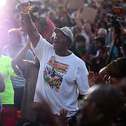 A strong supporter of the Martin family  shows his support during a rally for the shooting of Trayvon Martin on Thursday, March 22, 2012 at Fort Mellon Park in Sanford, Florida. (AP Photo/Alex Menendez) Trayvon Martin rally in Sanford, Florida.