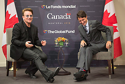 Prime Minister Justin Trudeau laughs at a comment from Bono during a meeting at the Global Fund conference Saturday, on September 17, 2016 in Montreal, QC, Canada. Photo by Paul Chiasson/The Canadian Press/ABACAPRESS.COM