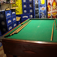 South America, Brazil, Rio de Janeiro. Pool table and bar room at the Favela of Vila Canoas.