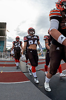 KELOWNA, BC - AUGUST 17:  Javen Kaechele #84 of Okanagan Sun walks to the field against the Westshore Rebels  at the Apple Bowl on August 17, 2019 in Kelowna, Canada. (Photo by Marissa Baecker/Shoot the Breeze)