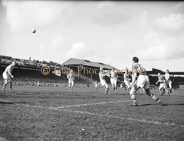 The ball is in mid air as players all run in the hope to gain possession during the All Ireland Senior Gaelic Football Final Kerry v Dublin in Croke Park on the 25th September 1955. Kerry 00-12 Dublin 01-06.