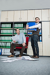 Businessmen busy sorting filing office
