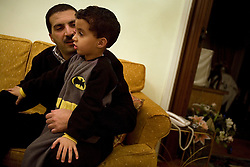 Amr Khaled and his son Ali, 4, are seen inside their home in the Mohandessin neighborhood of Cairo, Egypt, Dec. 28, 2005. Khaled, an Islamic televangelist, had previously been asked to leave Egypt as his revival gained strength. As a result he started preaching on several television shows, turning him into an international celebrity. Some religious scholars complain that Khaled has not been properly trained in Islam to command such a following.