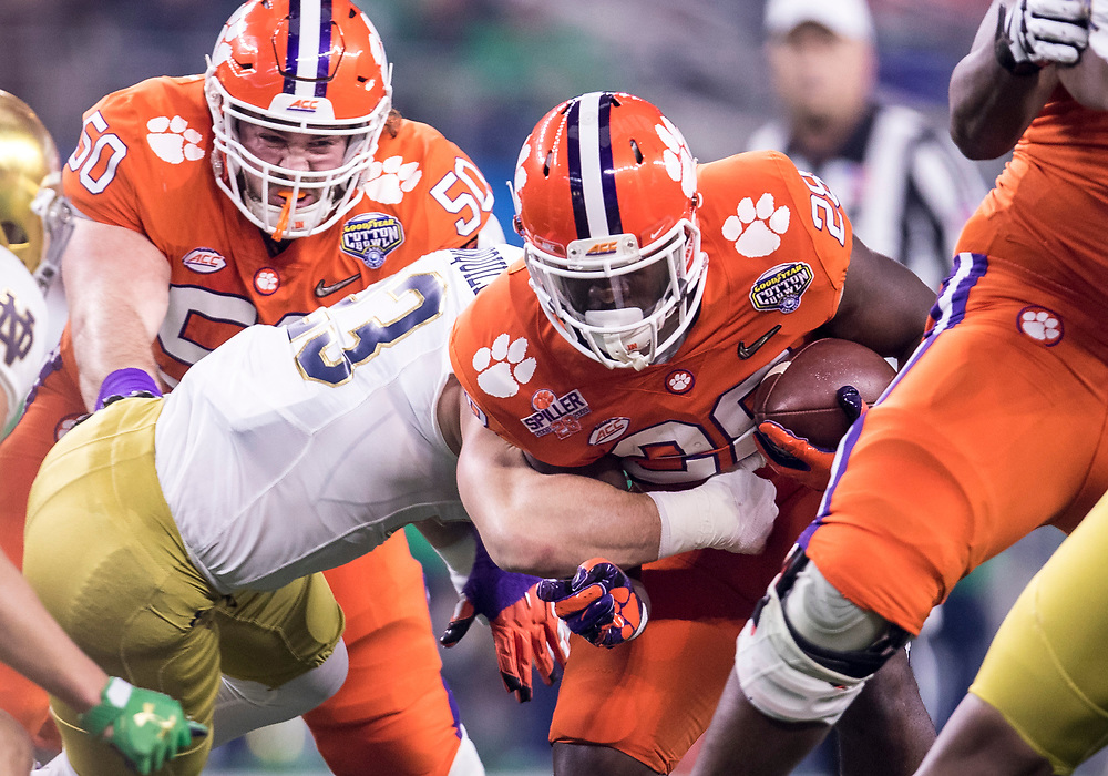 December 29, 2018:  Clemson running back Tavien Feaster (28) runs with the ball as Notre Dame linebacker Drue Tranquill (23) pursues uring NCAA Football game action between the Notre Dame Fighting Irish and the Clemson Tigers at AT&T Stadium in Arlington, Texas.  Clemson defeated Notre Dame 30-3.  John Mersits/CSM