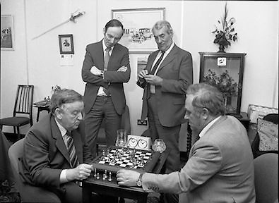 Chess Grand Masters, Clerys,,Dublin 1, Ireland. 1982.06.05.1982.05.06.1982.6th May 1982.USSR Chess Grandmaster visits Clerys. Mr Yefim Geller made a personal appearance in Clerys. Clerys sponsored the visit in conjunction with the Irish Chess Union, in agreement with the Russian Chess Federation... As Mr Geller plays against Mr Arthur Walls (CEO Clerys) they are watched by Mr Denis Ryan (Co Secretary) and Mr Donie Keane (General Manager Retail).