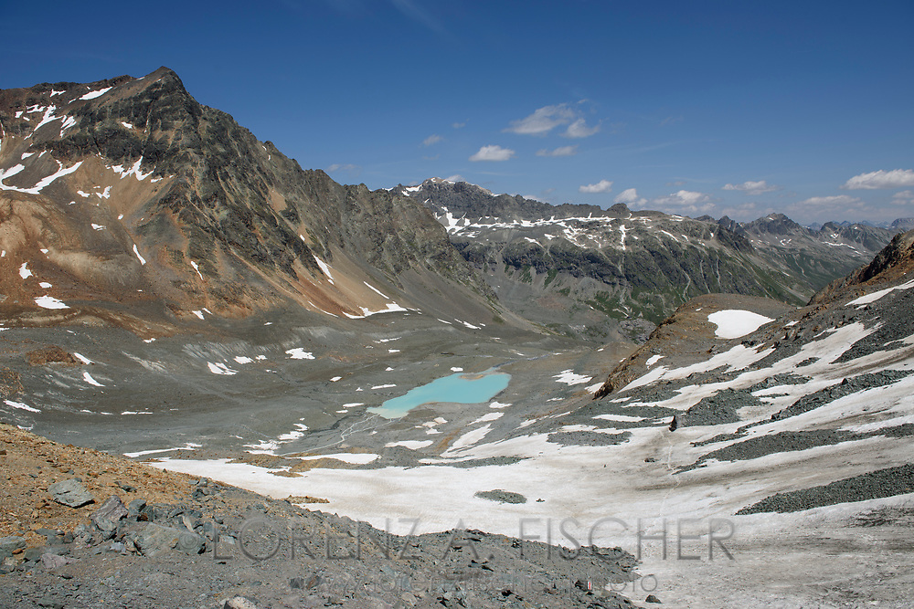 View from the Fuorcla d'Agnel to the Crasta Jenatsch and into the upper Val Bever with a glacier lake on a nice summer day in July, Engadin, Grisons, Switzerland