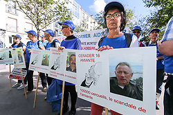 October 13, 2017 - Paris, Ile-de-France, France - Protestors from the National Association for the Defense of Victims of Asbestos (ANDEVA) and from others associations demonstrate to pass judgement on the people responsible for the asbestos victims in France, on October 13, 2017 in Paris. (Credit Image: © Michel Stoupak/NurPhoto via ZUMA Press)