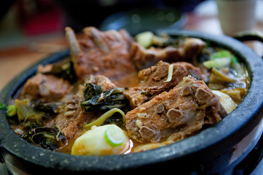 """Traditional """"Gamjatang"""" (Pork bone) soup in Daegu. Daegu, also known as Taegu and officially the Daegu Metropolitan City, is the third largest metropolitan area in South Korea, and by city limits, the fourth largest city with over 2.5 million people. The IAAF World Championships in Athletics will take place in Daegu from the 27th of August till the 4th of September 2011."""