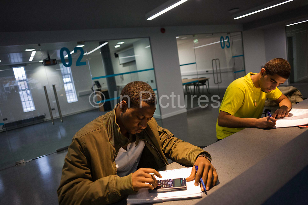Young men study at workstations in communal area at London Metropilitan University's Holloway Road campus. While one taps numbers on a calculator, another writes up course notes. London Metropolitan University is one of the foremost providers of undergraduate, postgraduate, professional and vocational education and training in Britain. Their courses are planned in consultation with employers and examining bodies in commerce, industry, the world of art and design, the financial services industries and other professions. To compare profiles, Oxford University has the lowest proportion of working-class students, with 11.5%. London Metropolitan University has the greatest proportion, with 57.2%. The first building, designed by Charles Bell, was opened in 1896.