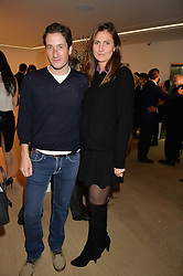 BLAISE PATRICK and FIAMMETTA EGALINI at an evening of Fashion, Art & design hosted by Ralph Lauren and Phillips at the new Phillips Gallery, 50 Berkeley Square, London on 22nd October 2014.