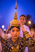 """01 FEBRUARY 2013 - PHNOM PENH, CAMBODIA:  A Cambodian Aspara dancer prepares to walk in the funeral procession of former Cambodian King Norodom Sihanouk. Norodom Sihanouk (31 October 1922- 15 October 2012) was the King of Cambodia from 1941 to 1955 and again from 1993 to 2004. He was the effective ruler of Cambodia from 1953 to 1970. After his second abdication in 2004, he was given the honorific of """"The King-Father of Cambodia."""" Sihanouk died in Beijing, China, where he was receiving medical care, on Oct. 15, 2012. His cremation is will be on Feb. 4, 2013. Over a million people are expected to attend the service.   PHOTO BY JACK KURTZ"""