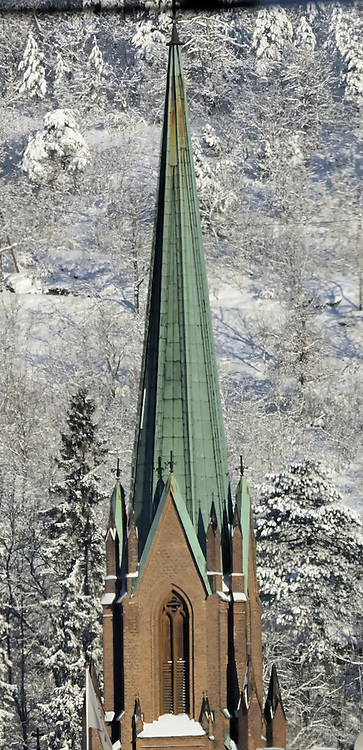 Church Steeple from the Oslo to Bergen Train. Image taken with a Nikon D2xs and 80-400 mm VR lens (ISO 100, 310 mm, f/9, 1/320 sec).