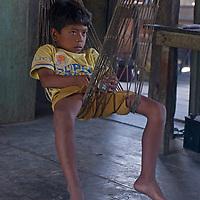 A Yanayacu Indian boy relaxes in a hammock in his family's hut in San Juan de Yanayacu village in Peru's Amazon Jungle.