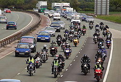 © licensed to London News Pictures. Ellesmere Port, UK 08/05/2011. Bikers on the M56 near Lymm, on the way to a blockade at Stanlow Oil Refinery. Organiser, Ian Charlesworth says that a 24 pence discount off the price of a litre of petrol is required to bring the UK in line with average European pricing and to keep British businesses competitive. He says he is expecting more than 1000 vehicles to turn up and is expecting to stay for at least a week. Please see special instructions for usage rates. Photo credit should read Joel Goodman/LNP