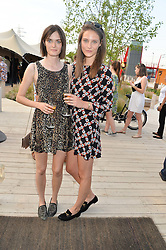 Left to right, SAM ROLLINSON and CHARLOTTE WIGGINS at a reception hosted by Eco World Ballymore and the English National Ballet to celebrate their partnership at London City Island, Orchard Place, London E14 on 1st July 2015