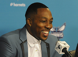 June 26, 2017 - Charlotte, NC, USA - The Charlotte Hornets' newest center Dwight Howard laughs as he answers a question during a news conference on Monday, June 26, 2017 at the Spectrum Center in Charlotte, N.C. (Credit Image: © David T. Foster Iii/TNS via ZUMA Wire)