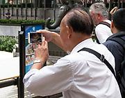 Tourists at Rockefeller Center, New York City, NY, USA