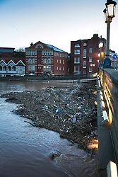 © Licensed to London News Pictures. 13/2/2014. Worcester, UK. The River Severn flowing through Worcester reaches an all time high. Pictured, river waste buils up under the main Worcester bridge. Photo credit : Dave Warren/LNP