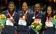 United States gold-medal winning 1,600-meter relay (from left): Demetria Washington, Sanya Richards, Jearl Miles-Clark and Me'Lisa Barber in the IAAF World Championships in Athletics at Stade de France on Sunday, Aug. 31, 2003.