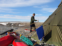Putting up the tipi in the sun in the prince Karl headland strait on Spitzbergen