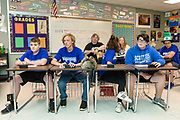 Buzzers ready, the Glasgow team members wait for round one to begin, with their coach Laura Cline, Melissa Parocai and her son and substitute player William Parocai seated behind them. The Glasgow High School Quiz Bowl team members are, from left, Whit Muhlenkamp,  14, 8th grade, William Parocai, 14, 8th grade, Gabbie Houchens, 14, 8th grade and Andres Garcia, 14, 8th grade. Behind them are their substitute player, Tayvcon? Wood, 14, 8th grade, and coach, Laura Cline (270-991-5203.)<br /> <br /> Teams compete in the preliminary rounds of the 2019 Kentucky Quiz Bowl Alliance Middle School State championship Saturday, April 27, 2019, at Noe Middle School in Louisville, Ky. (Photo by Brian Bohannon)