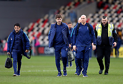 Tottenham Hotspur manager Mauricio Pochettino and assistant manager Jesus Perez (left) arrive at the pitch during the Emirates FA Cup, fourth round match at Rodney Parade, Newport.