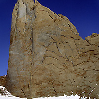 ANTARCTICA, Queen Maud Land. Expedition members below Rakekniven spire, Filchner Mts.  Route follows cracks right of summit.