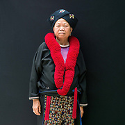 An ethnic Yao/Mien woman from Chiang Rai province at Baan Tong Luang, Eco-Agricultural Hill Tribes Village on 7th June 2016 in Chiang Mai province, Thailand. The fabricated village is home to 8 different hill tribes who make a living from selling their handicrafts and having their photos taken by tourists