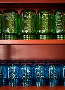 Blue and green mason jars at The Farmer's Table in Fayetteville, Arkansas. A farm to table, local and organic, restaurant in Northwest Arkansas.<br /> Photo by Beth Hall