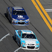 Danica Patrick (10) and Dale Earnhardt Jr. (88) are seen as they race down the front stretch during the 58th Annual NASCAR Daytona 500 auto race at Daytona International Speedway on Sunday, February 21, 2016 in Daytona Beach, Florida.  (Alex Menendez via AP)