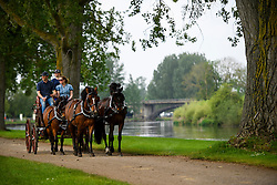 © London News Pictures. 12/05/2016. Windsor, UK. A horse drawn carriage makes its way along the banks of the River Thames on he first day of the 2016 Royal Windsor Horse Show, held in the grounds of Windsor Castle in Berkshire, England. The opening day of the event was cancelled due to heavy rain and waterlogged grounds. This years event is part of HRH Queen Elizabeth II's 90th birthday celebrations.  Photo credit: Ben Cawthra/LNP