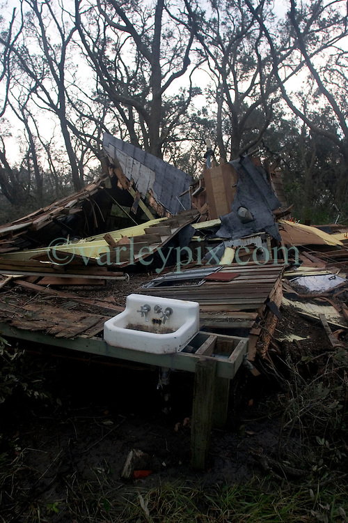 25 Sept, 2005. Carlyss, Louisiana. Hurricane Rita aftermath. <br /> The destroyed remains of a bayou home one day after the storm ravaged the area. The exterior sink seems to be the only thing to survive the storm.<br /> Photo; ©Charlie Varley/varleypix.com