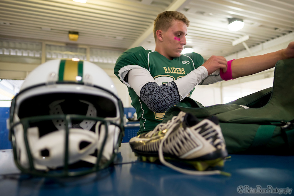 Rio Americano Raiders Sam Cooperman-Earl (36), gets ready inside the locker room before the game as the El Camino Eagles host the Rio Americano Raiders at Del Campo High School, Friday Oct 7, 2016. <br /> photo by Brian Baer