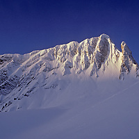 A lesser known summit of India's Great Himalaya range, near Pahalgam, Kashmir, glows in a morning sunrise.