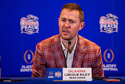 The Oklahoma Sooners head coach Lincoln Riley answers questions from the media at the Omni Hotel on Monday, Dec. 23, 2019, in Atlanta. LSU will face Oklahoma in the 2019 College Football Playoff Semifinal at the Chick-fil-A Peach Bowl. (Jason Parkhurst via Abell Images for the Chick-fil-A Peach Bowl)