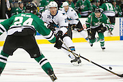 DALLAS, TX - OCTOBER 17:  James Sheppard #15 of the San Jose Sharks passes the puck against the Dallas Stars on October 17, 2013 at the American Airlines Center in Dallas, Texas.  (Photo by Cooper Neill/Getty Images) *** Local Caption *** James Sheppard