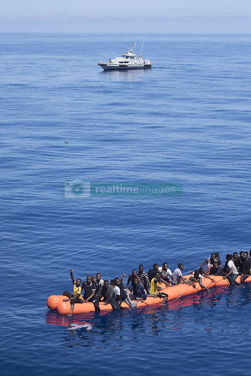 Italy - May 25, 2018.Sea-Watch migrant rescue operations in the Mediterranean Sea..SAR-Case 341: After the so-called Libyan Coast Guard intervened in an ongoing Sea-Watch rescue operation, a large group of panicking refugees jumped from a rubber boat onto a floating rescue device and into the water. The most catastrophic consequences could only be avoided by a retreat of the Libyan vessel and determined action by the Sea-Watch rescue crew. But as the crew found out in a survey among the survivors, still five people went missing in the incident. (Credit Image: © Chris Grodotzki /Seawatch/Ropi via ZUMA Press)