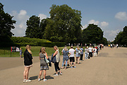 On the day after what would have been the 60th birthday of Princess Diana, people queue up outside Kensington Palace to view the newly revealed statue of her in Kensington Palace Gardens on 2nd July 2021 in London, United Kingdom. Diana, Kensington Palace was the former residence of Princess of Wales became known as the Peoples Princess following her tragic death.
