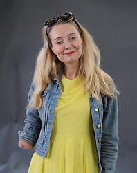 "Cerrie Burnell appears at the 2019 Edinburgh International Book Festival.<br /> <br /> Claire ""Cerrie"" Burnell (born 30 August 1979, is an English actress, singer, playwright, children's author, and former television presenter for the BBC children's channel CBeebies.<br /> <br /> Burnell was born with a right arm that ends just below the elbow. Her initial appearance on CBeebies sparked a controversy about children's television presenters with physical disabilities and the apparent prejudice of complainants. <br /> <br /> © Dave Johnston / EEm"
