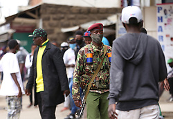 May 11, 2020, Nairobi, Kenya: A police officer patrols the Eastleigh area during the demonstration..Eastleigh Residents took to the street to protest restriction of movement in the area due to the widespread case of Covid-19 within the residential area and appealed to the government to provide them with relief food. Kenya has confirmed 672 cases of Covid-19 and 32 deaths. (Credit Image: © Billy Mutai/SOPA Images via ZUMA Wire)