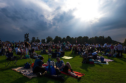 © Licensed to London News Pictures.22/08/15<br /> Castle Howard, North Yorkshire, UK. <br /> <br /> Storm clouds gather as hundreds of people attend the 25th anniversary of the Castle Howard Proms event near York. The theme of the event this year is a commemoration of the 75th anniversary of the Battle of Britain and the 70th anniversary of VE day and brings an evening of classic musical favourites celebrating Britishness to the lawns of Castle Howard.<br /> <br /> Photo credit : Ian Forsyth/LNP