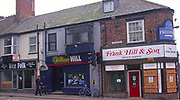 A293GF Closed businesses boarded up Hornsea Yorkshire England