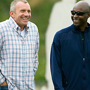 Joe Montana and Jerry Rice share a laugh at Steve Clarkson's Super 7 quarterback camp in Santa Barbara, California.