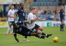 Dundee's Genseric Kusunga tackled Ayr United's Mike Moffat and gets a red card. Dundee 0 v 3 Ayr United, Scottish League Cup Second Round, played 18/8/2018 at the Kilmac Stadium at Dens Park, Scotland.