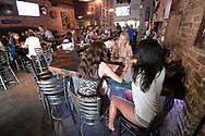 Patrons sit and mingle inside the Dapper Duck bar and restaurant Friday, June 23, 2017, in downtown Orlando, Fla. (Phelan M. Ebenhack via AP)
