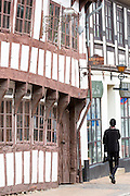 Medieval buildings and tourist in in street scene in the old town in Odense on Funen Island, Denmark