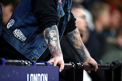 Detail of tattoos on a West Ham United fan